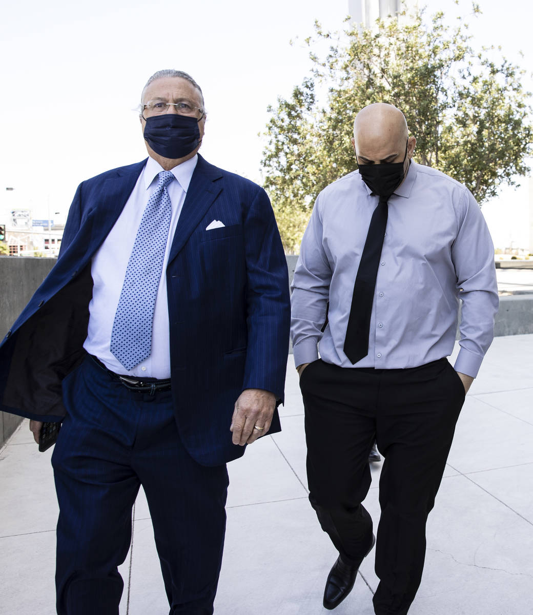Hip-hop producer known as Mally Mall, right, leaves the Lloyd D. George Federal Courthouse with ...