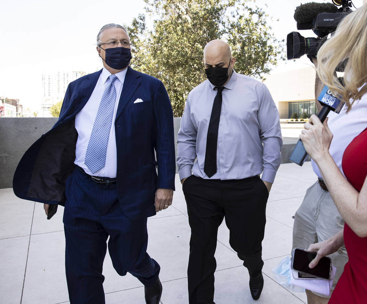 Hip-hop producer known as Mally Mall, center, leaves the Lloyd D. George Federal Courthouse wit ...