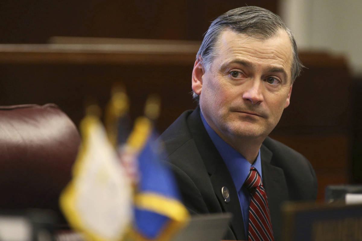 FILE - In this Feb. 27, 2013, file photo, Nevada Sen. James Settelmeyer, R-Minden, listens on t ...