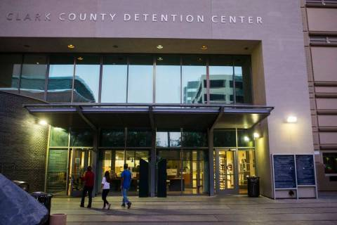 People walk outside of the Clark County Detention Center in downtown Las Vegas on Tuesday, Oct. ...