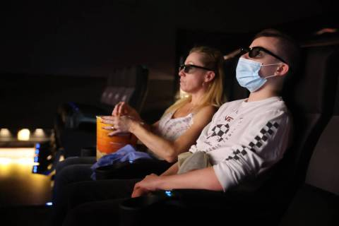 "Taylor and Patti Schoffstall of San Diego watch the 4D release of ""Godzilla vs. Kong"" ..."