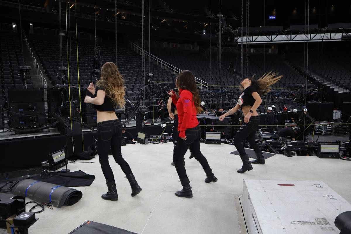 """The cast of """"X Rocks"""" is shown in rehearsal at T-Mobile Arena prior to the opening of the Metal ..."""