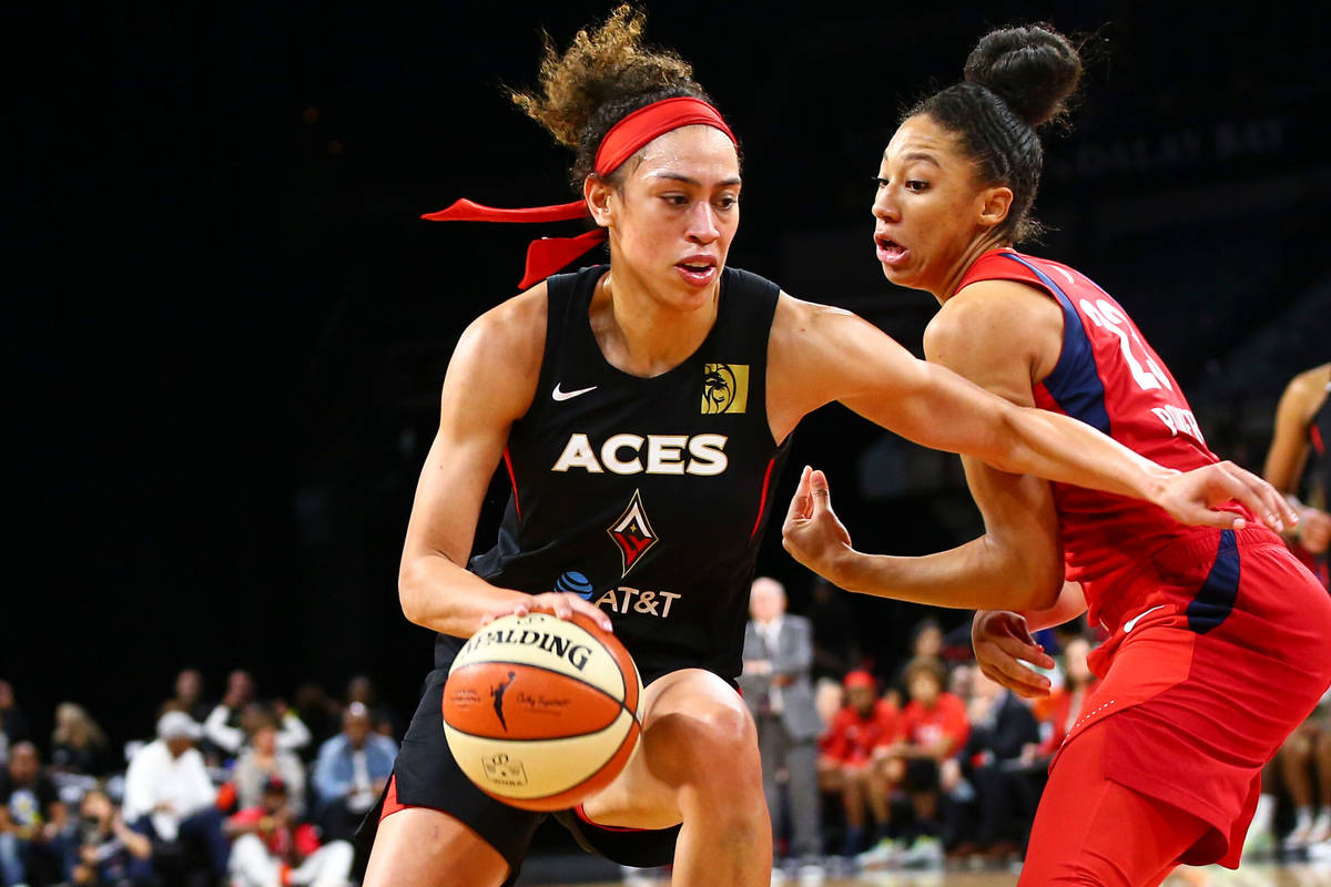 Las Vegas Aces' Dearica Hamby drives to the basket against Washington Mystics' forward Aerial P ...