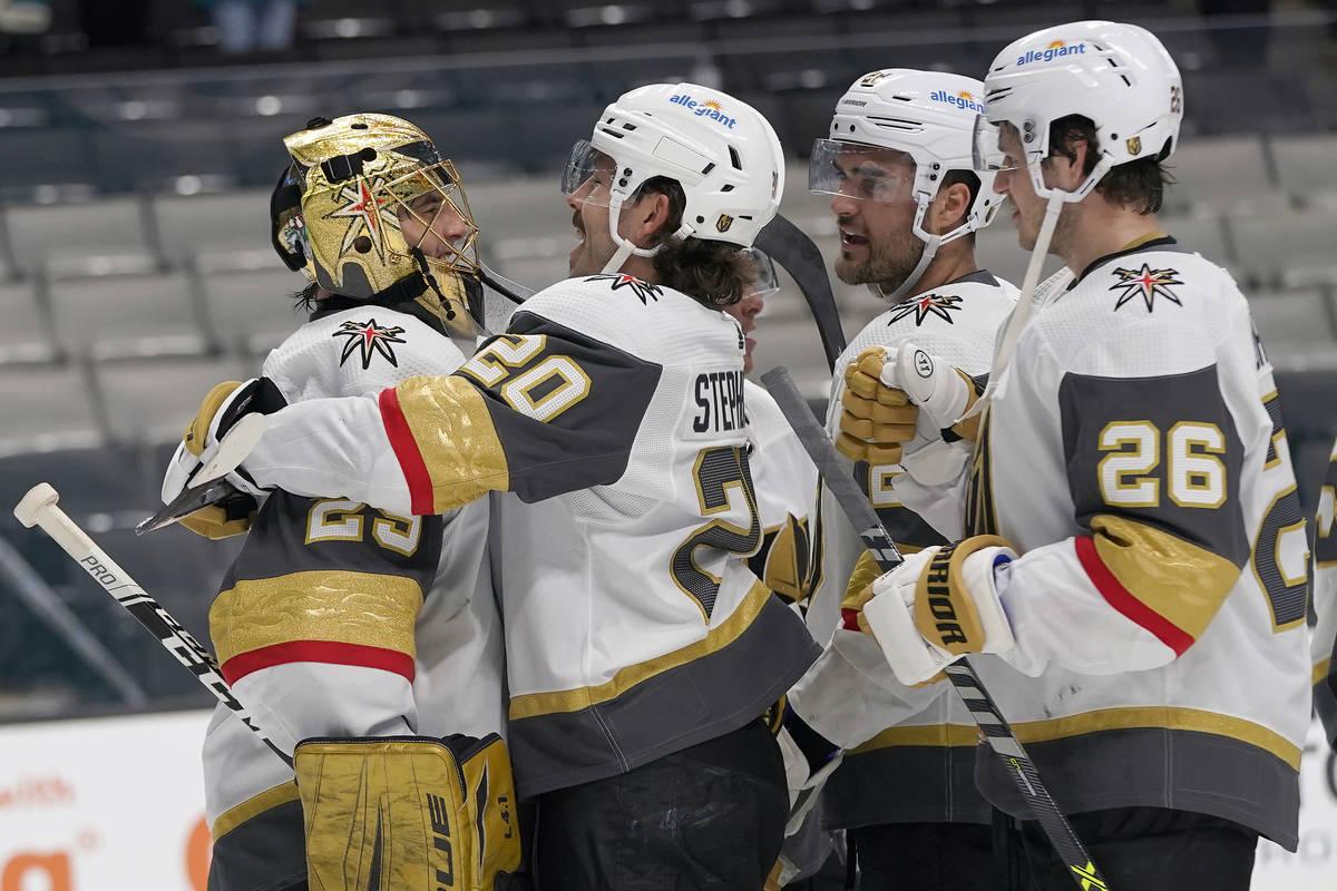 Vegas Golden Knights goaltender Marc-Andre Fleury, left, celebrates with Chandler Stephenson, W ...
