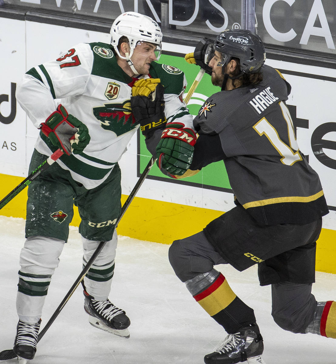 Minnesota Wild center Kyle Rau (37) takes a shot to the chin from Golden Knights defenseman Nic ...