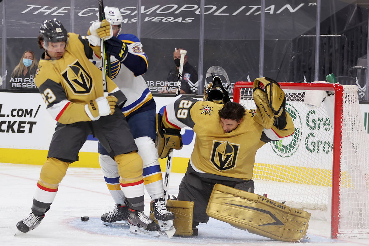 Vegas Golden Knights goaltender Marc-Andre Fleury (29), with defenseman Alec Martinez (23), get ...