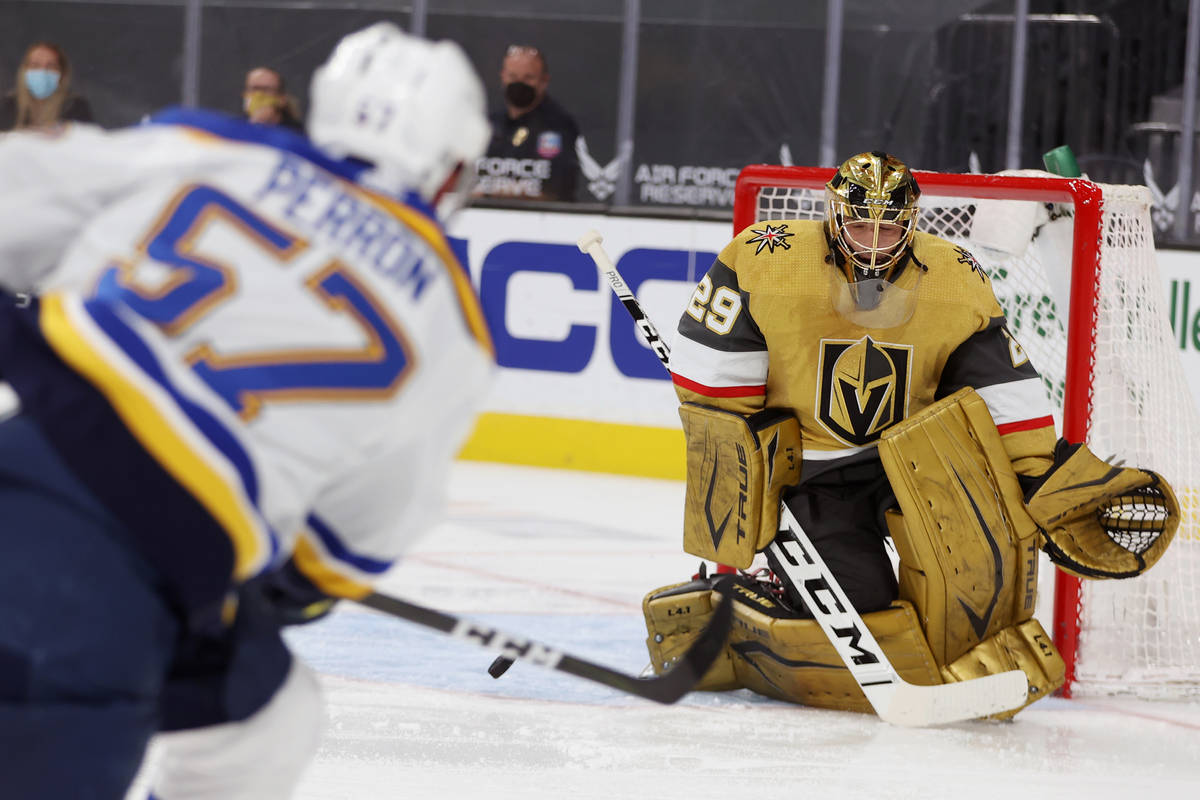 Vegas Golden Knights goaltender Marc-Andre Fleury (29) defends a shot from St. Louis Blues left ...