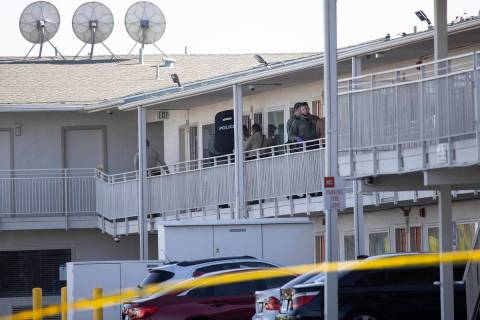 Police investigate the scene of a homicide at the Motel 6 near Koval Lane and Tropicana Avenue ...