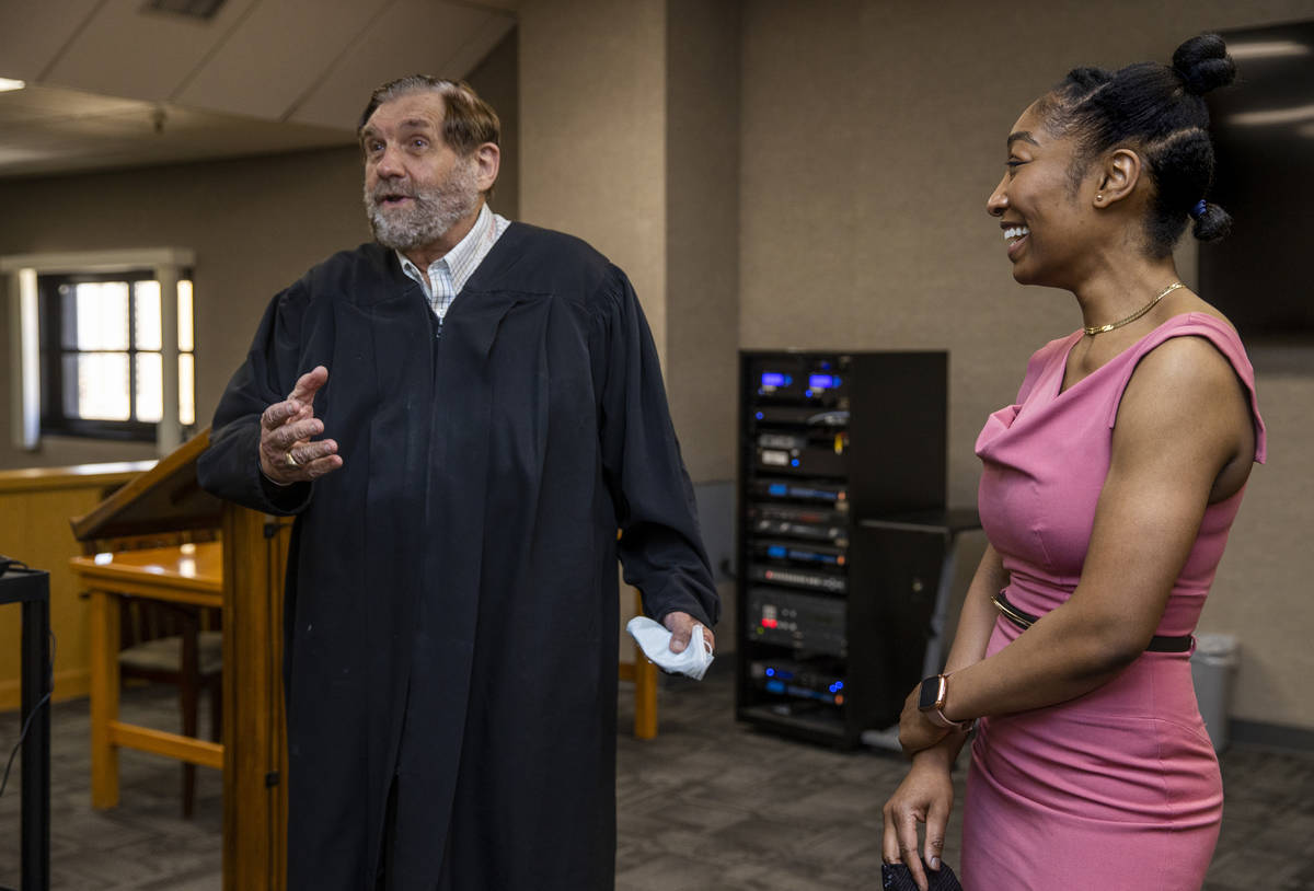 Justice Michael Cherry, left, talks about his days in law school prior to a swearing in ceremon ...