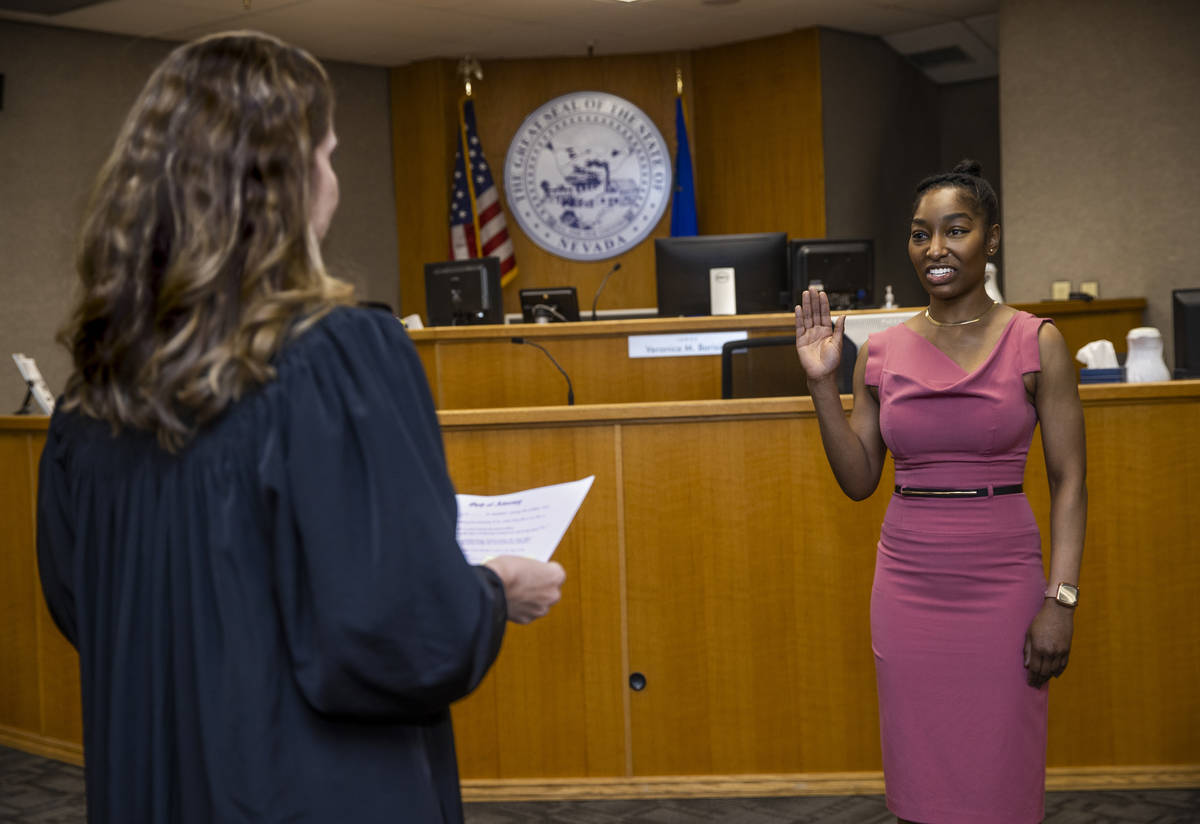 Dominique Bosa-Edwards, right, a former District Court marshal, is sworn in by Judge Veronica M ...