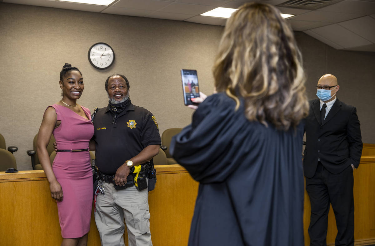 Dominique Bosa-Edwards, left, a former District Court marshal, who passed the Nevada State Bar ...