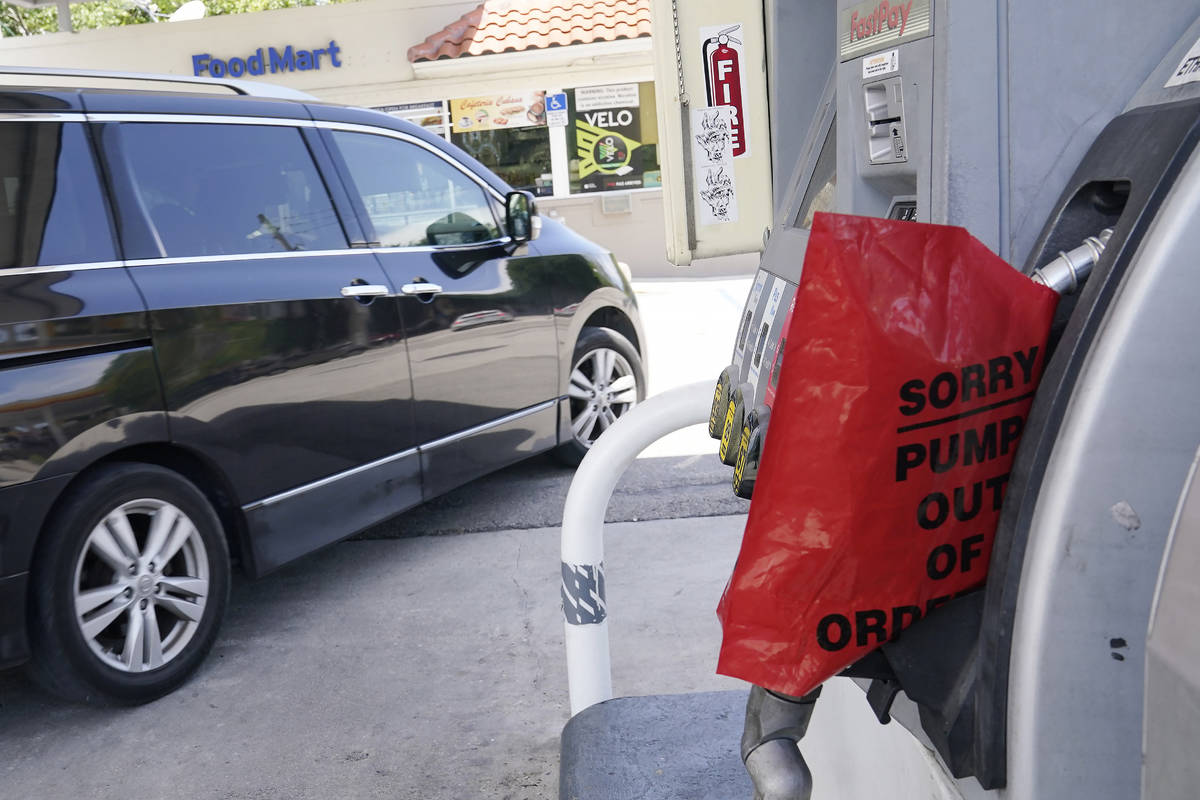 A customer drives from a Chevron station after it ran out of gasoline, Wednesday, May 12, 2021, ...