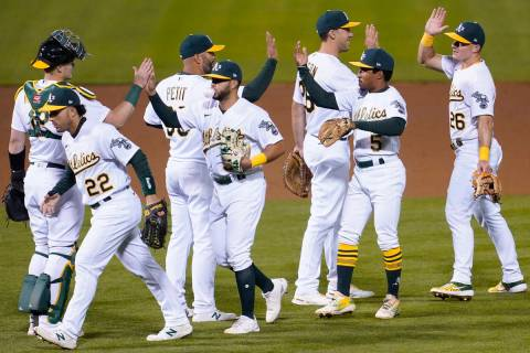 Oakland Athletics' Sean Murphy, from left, celebrates with Ramon Laureano (22), Yusmeiro Petit, ...