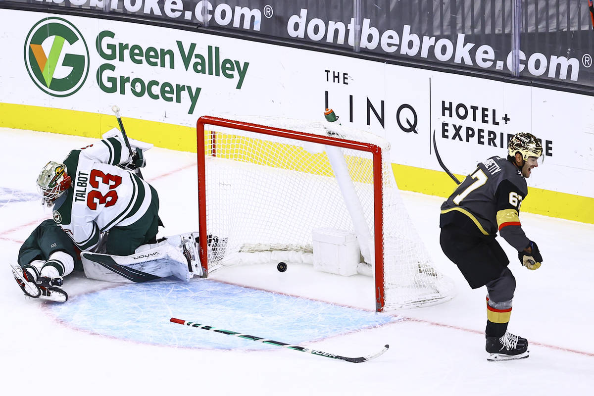 Golden Knights left wing Max Pacioretty (67) scores a goal in overtime past Minnesota Wild goal ...