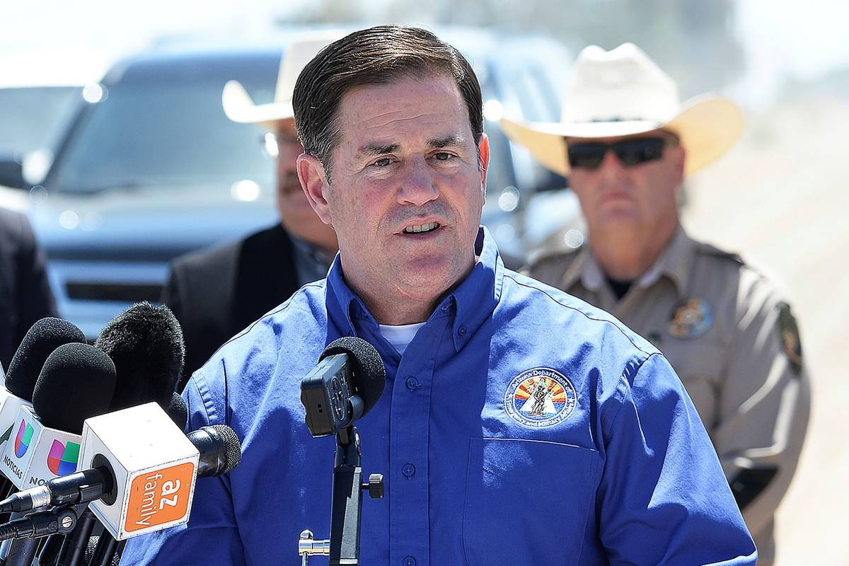 Arizona Gov. Doug Ducey addresses the media at the U.S-Mexico border in Yuma, Ariz., in April 2 ...