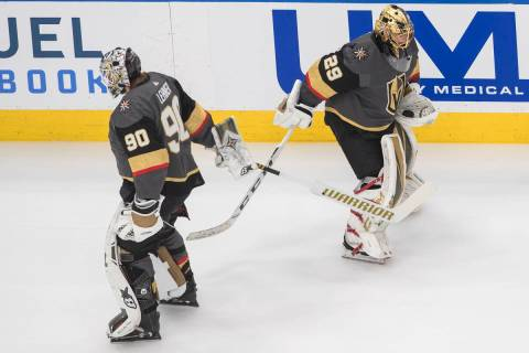 Vegas Golden Knights goalie Robin Lehner (90) and goalie Marc-Andre Fleury (29) tap sticks duri ...