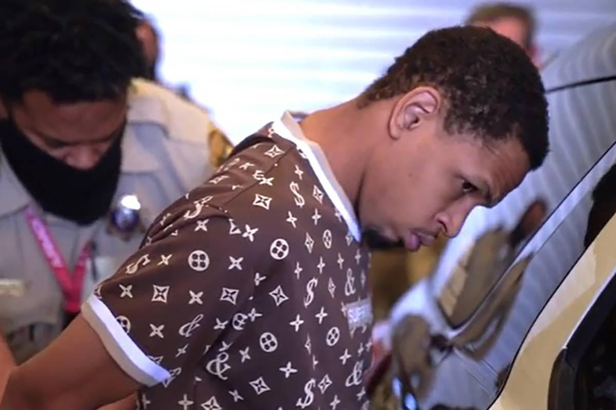 Terrell Rhodes is transferred to a vehicle by Las Vegas police. (Las Vegas Metropolitan Police ...