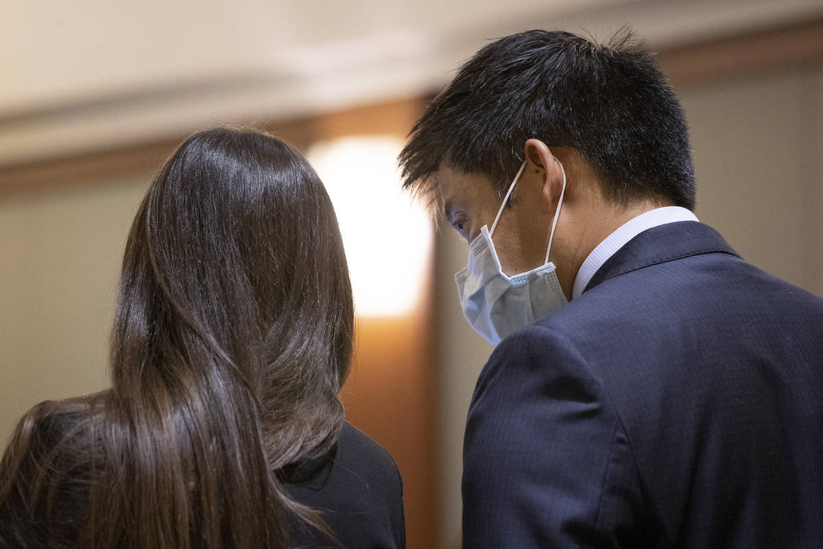 Prosecutor Alex Chen confers with prosecutor Brianna Stutz during a court hearing for Zane Floy ...