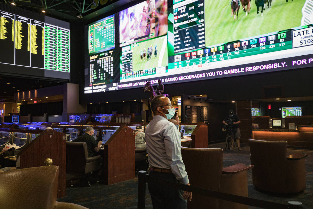 Jay Kornegay, vice president of Westgate Sportsbook, makes a phone call on the first day of the ...