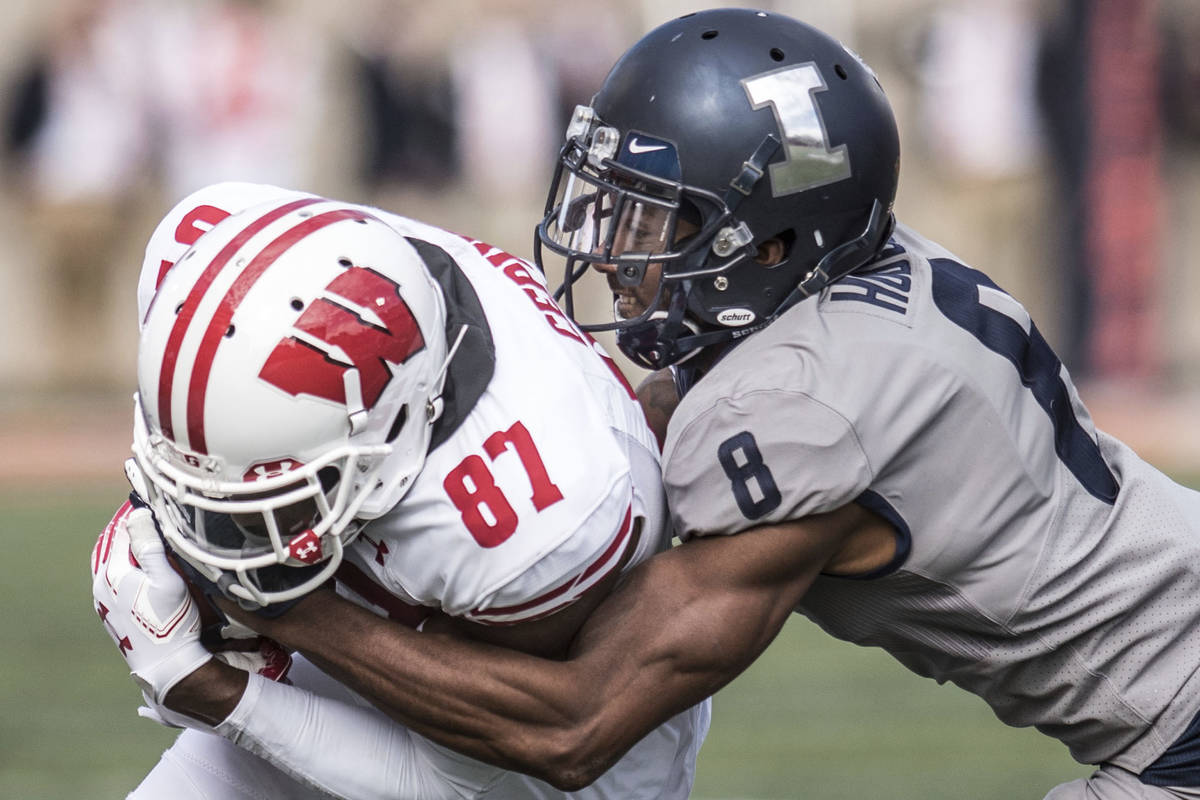 In this Oct.19, 2019, file photo, Illinois defender Nate Hobbs (8) takes down Wisconsin's Quint ...