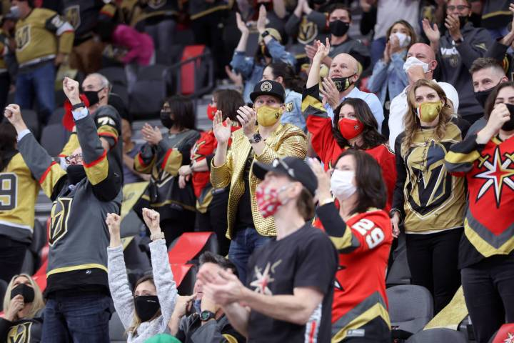 Fans celebrate a score by the Vegas Golden Knights gains the St. Louis Blues during the third p ...