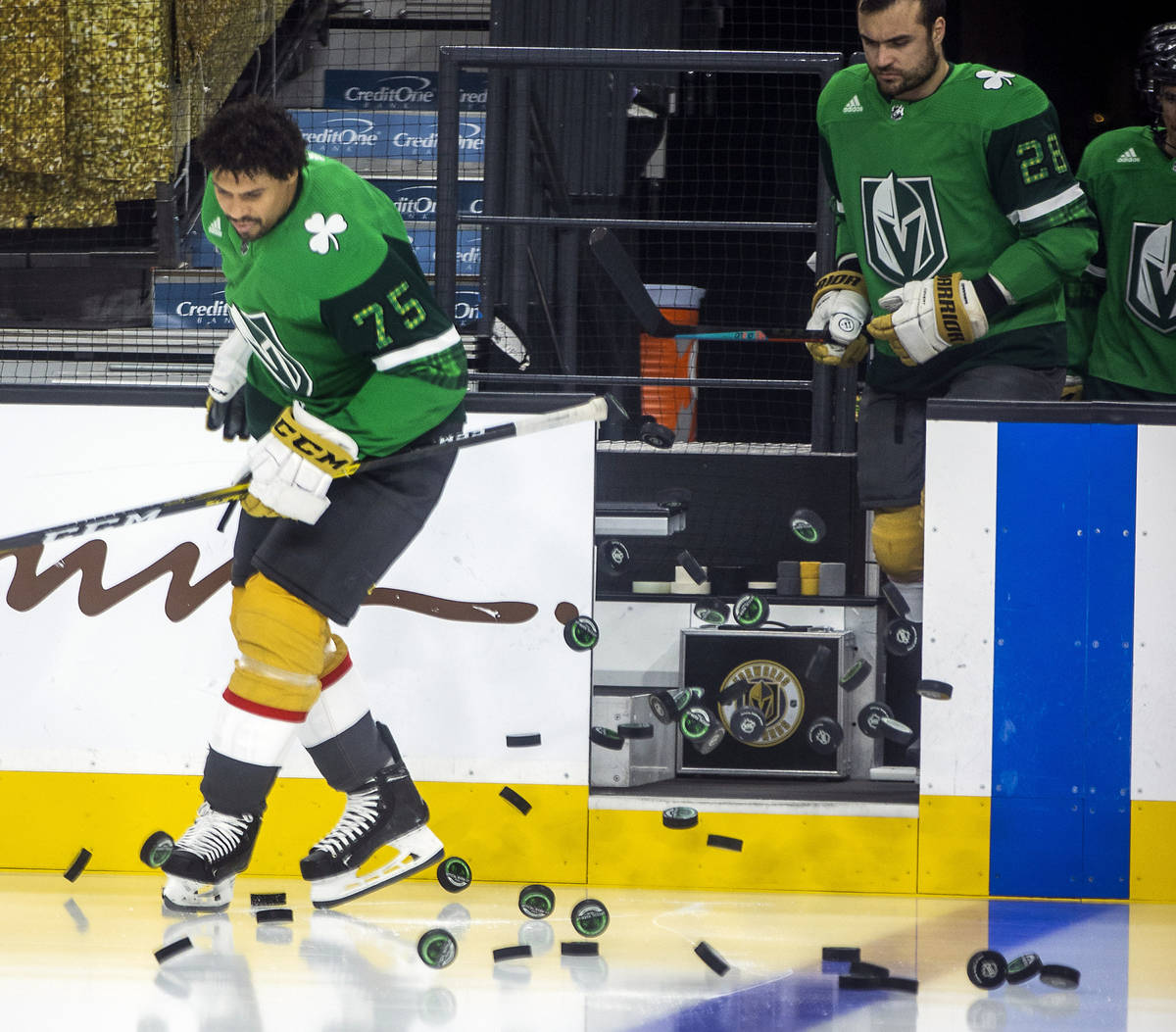 Golden Knights right wing Ryan Reaves (75) and teammate left wing William Carrier (28) take to ...