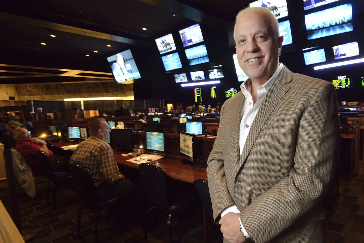 Art Manteris, vice president for race and sports operations at Station Casinos, is shown in par ...