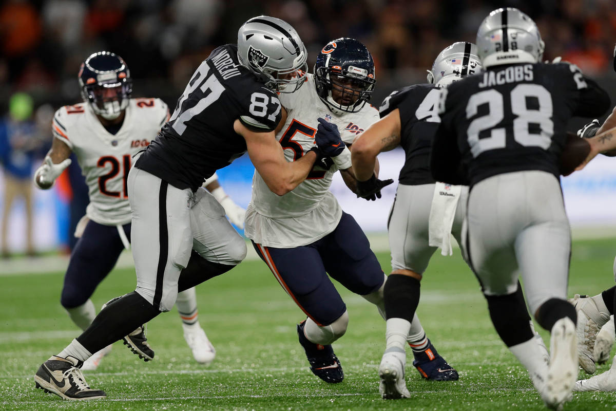 Chicago Bears outside linebacker Khalil Mack (52) is blocked by Raiders tight end Foster Moreau ...