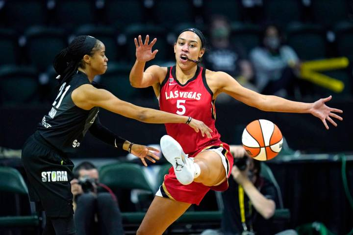 Las Vegas Aces' Dearica Hamby (5) defends against Seattle Storm's Jordin Canada in the first ha ...