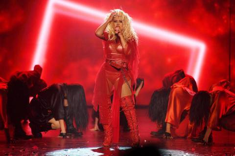 Christina Aguilera performs at the grand opening of her new show at Planet Hollywood on June 1, ...