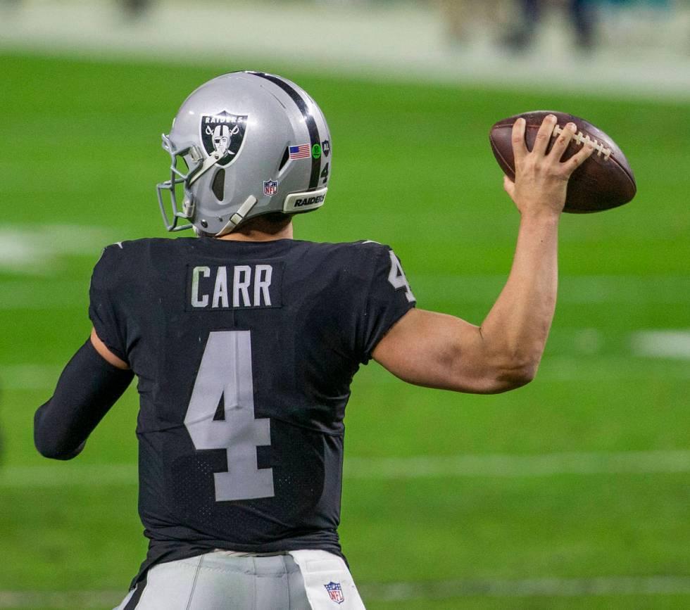 Raiders quarterback Derek Carr (4) throw against the against the Miami Dolphins during the four ...