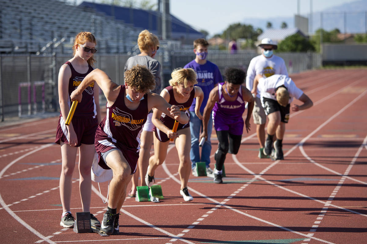 High school track and field athletes compete in the 4x400-meter race during a meet at Durango H ...