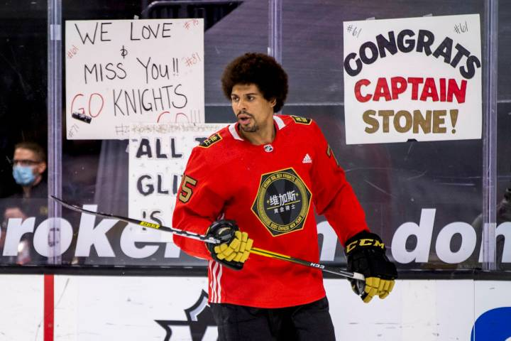 Golden Knights right wing Ryan Reaves (75) keeps a puck in the air during warm ups before the f ...
