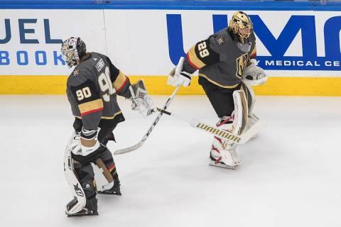 Vegas Golden Knights goalie Robin Lehner (90) and goalie Marc-Andre Fleury (29) tap sticks duri ...