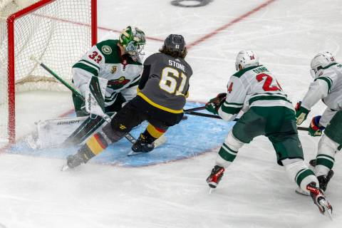 Golden Knights right wing Mark Stone (61) looks to shoot on Minnesota Wild goaltender Cam Talbo ...