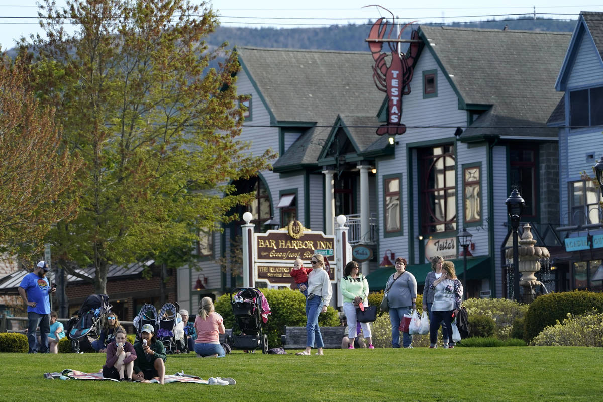 Visitors gather at a waterfront park, Saturday, May 15, 2021, in Bar Harbor, Maine. Gov. Janet ...