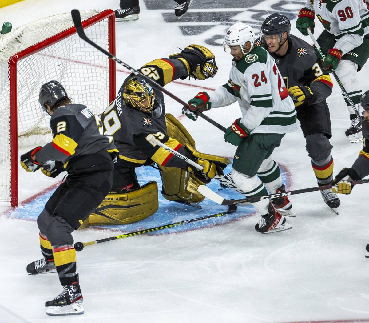 Golden Knights goaltender Marc-Andre Fleury (29) defends the net as Minnesota Wild defenseman M ...