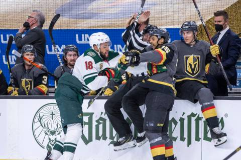 Golden Knights right wing Ryan Reaves (75) and Minnesota Wild left wing Jordan Greenway (18) ta ...