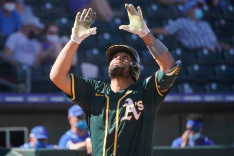 Oakland Athletics' Francisco Pena gestures as he crosses the plate with a home run in the sixth ...