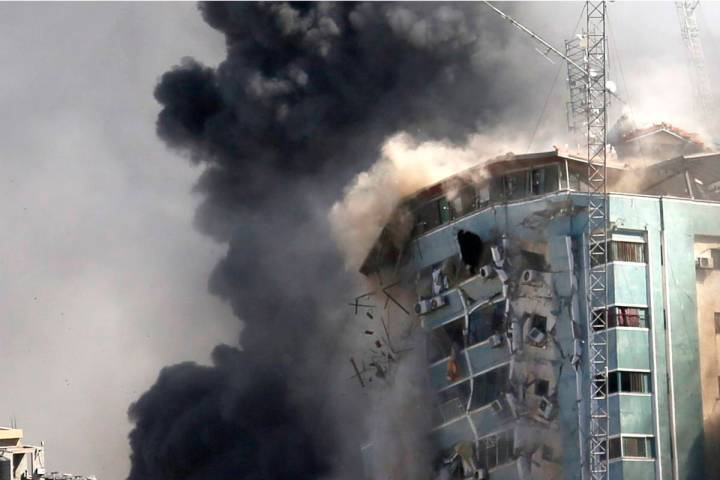 The building housing the offices of The Associated Press and other media in Gaza City collapses ...