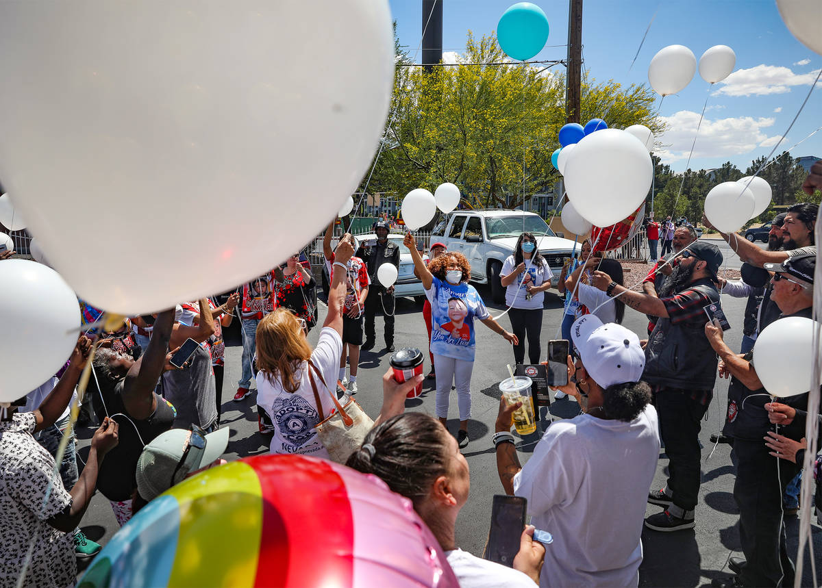 Zak Ramons, center, aunt to Amari Nicholson, leads a balloon release in honor of Amari, the 2-y ...