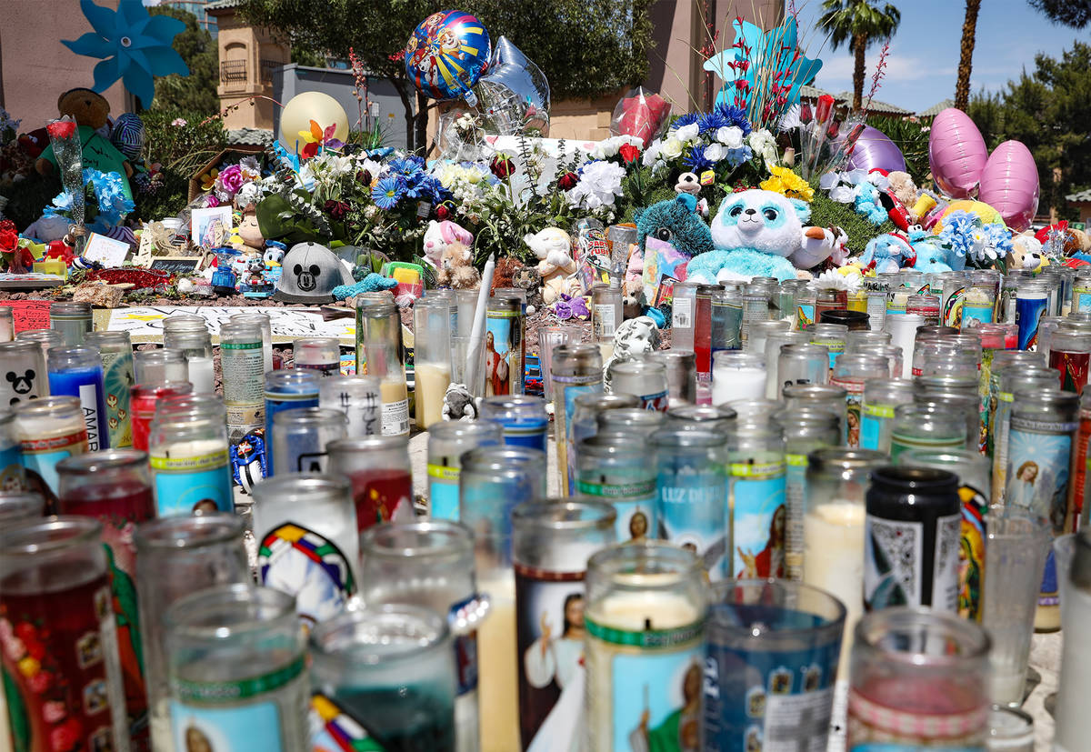 Candles and trinkets for 2-year-old Amari Nicholson, who was killed earlier in the month, near ...