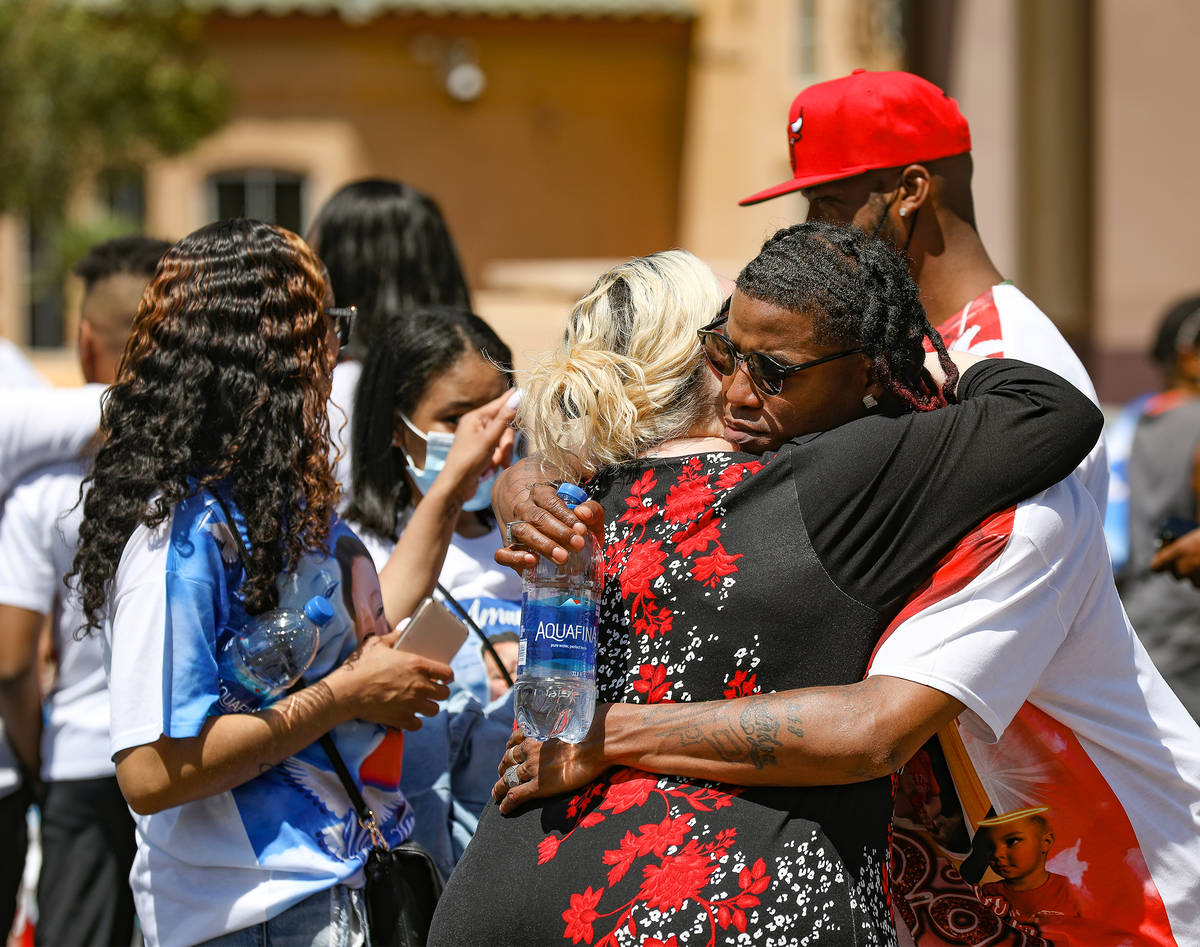 Erica Hayes, left, hugs Jyrgio Hayes, right, her brother-in-law and father to 2-year-old Amari ...