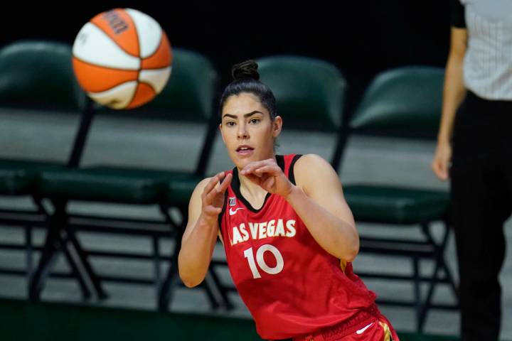 Las Vegas Aces' Kelsey Plum reaches for the ball during the first half of a WNBA basketball gam ...