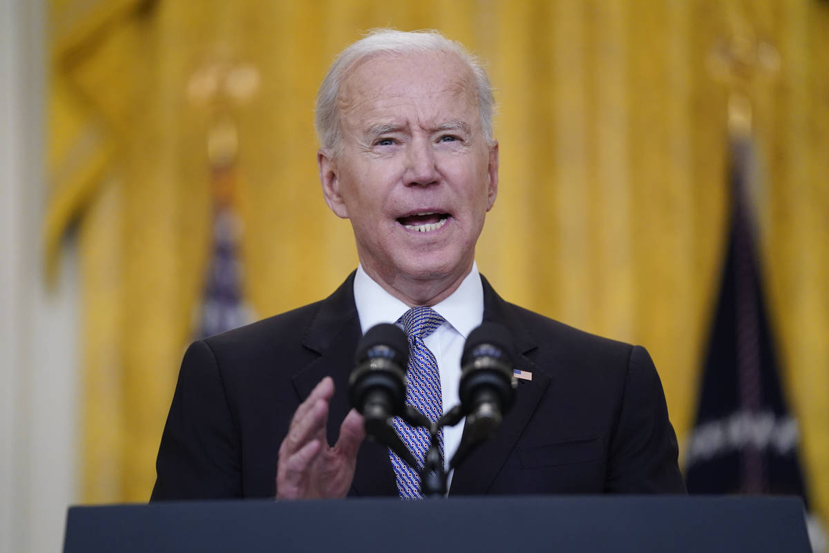 President Joe Biden speaks about distribution of COVID-19 vaccines, in the East Room of the Whi ...