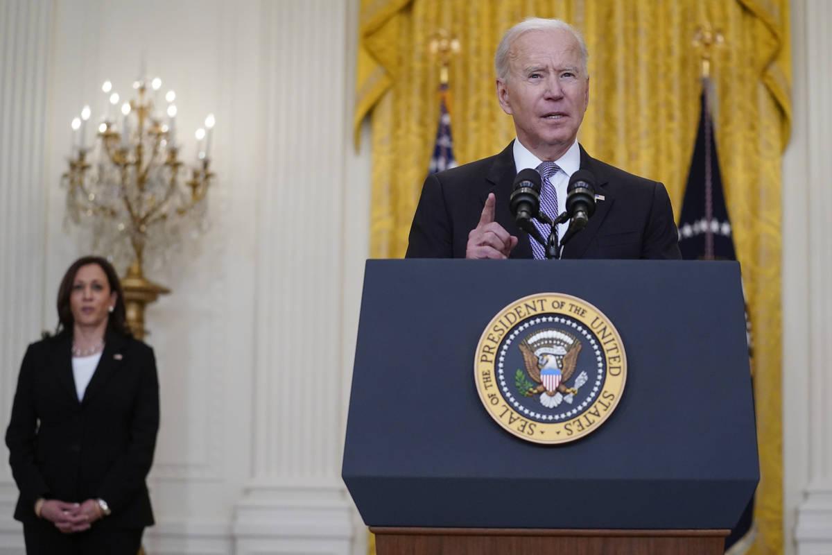 Vice President Kamala Harris listens as President Joe Biden speaks about distribution of COVID- ...
