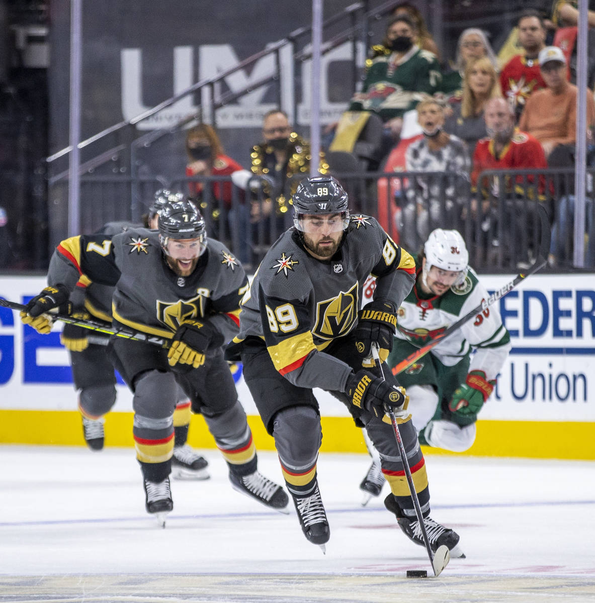 Golden Knights right wing Alex Tuch (89) breaks free up the ice for a shot attempt with teammat ...