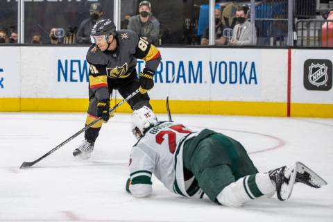 Golden Knights center Jonathan Marchessault (81) looks to shoot asMinnesota Wild defenseman Jon ...