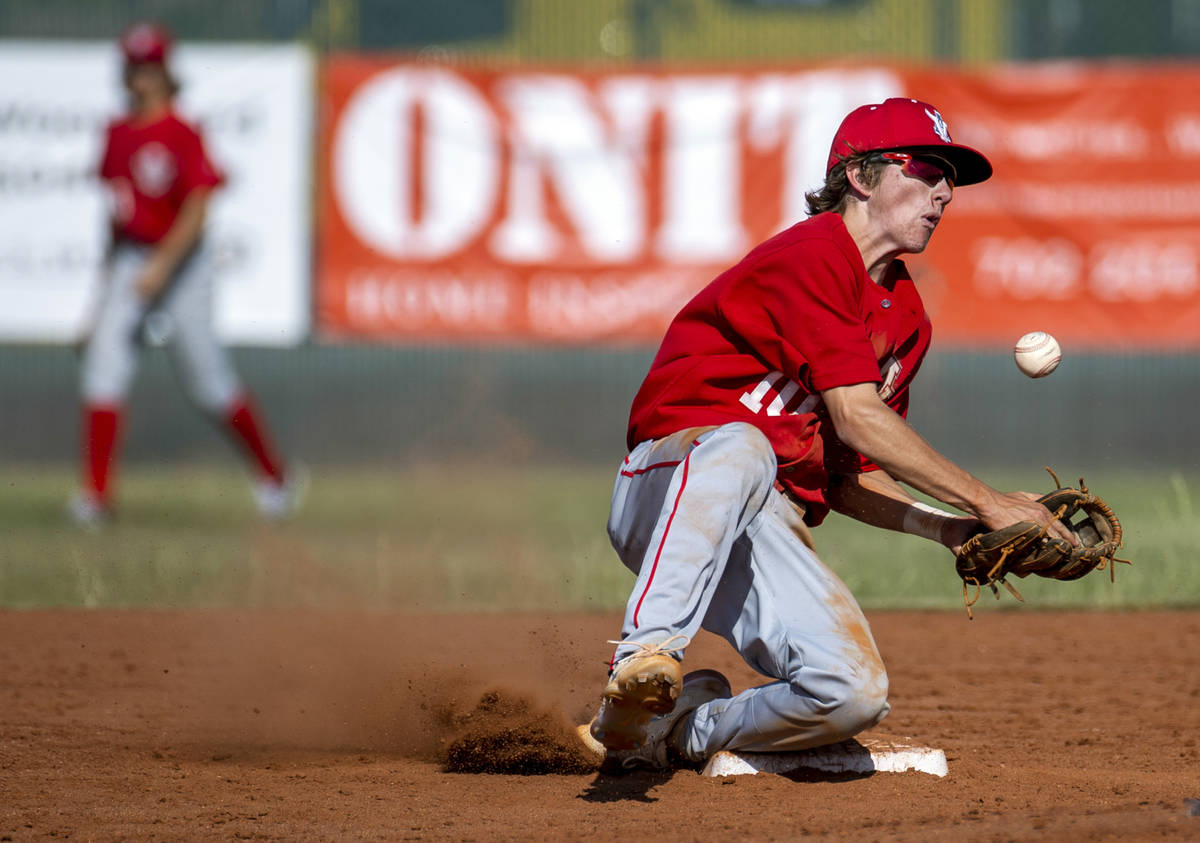Arbor View infielder Park Roeder (10) bobbles a throw to second base versus Liberty during the ...