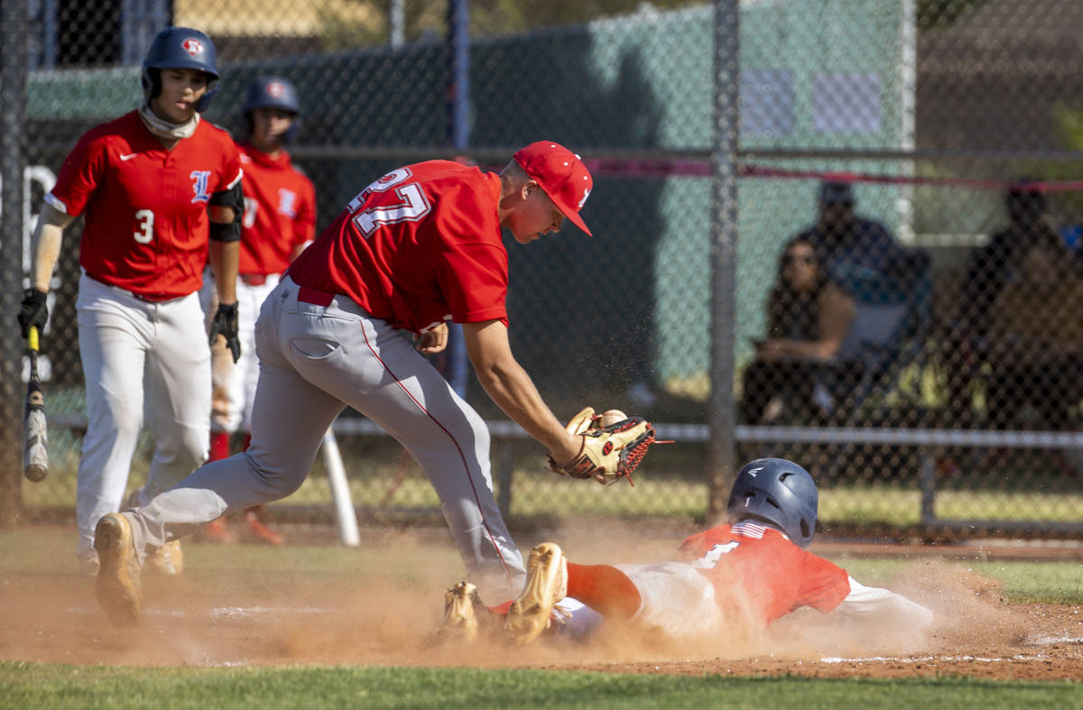 Arbor View pitcher Braxton Bybee (27) is late on the tag at home plate as Liberty runner Bret M ...